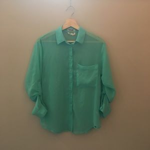 Cute turquoise transparent shirt.